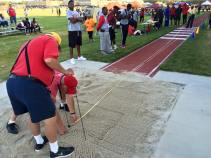 Officials re-measure Zakiyy Williams' meet-record 47-4 1/2 in the triple jump Friday.